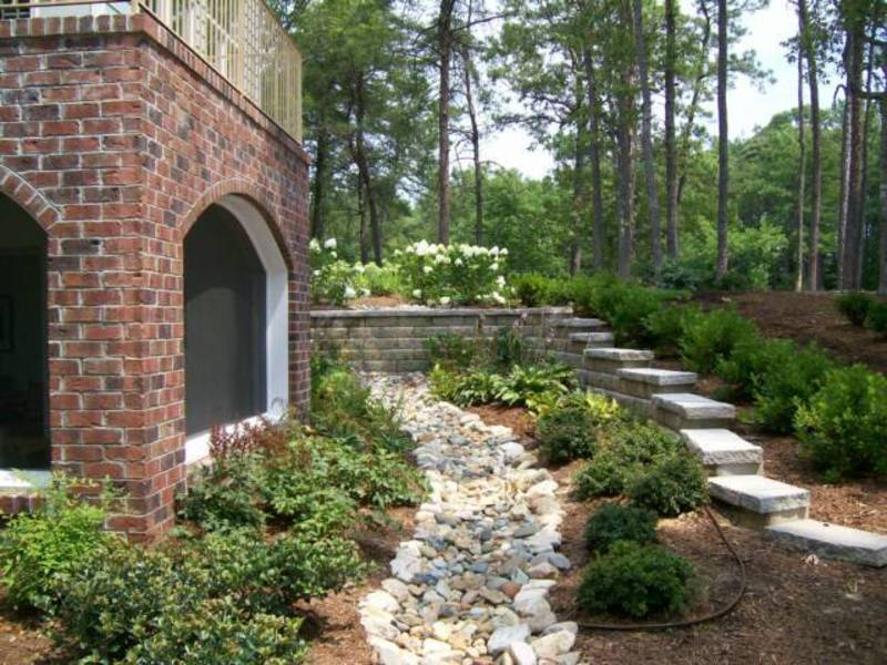DIY dry creek bed for downspout drainage - the perfect solution and stylish trend to landscaping