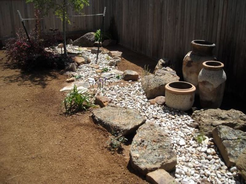 Desert styled dry creek bed, perfect for low maintenance