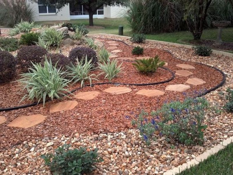 Red stone dry river creek bed landscaping ideas