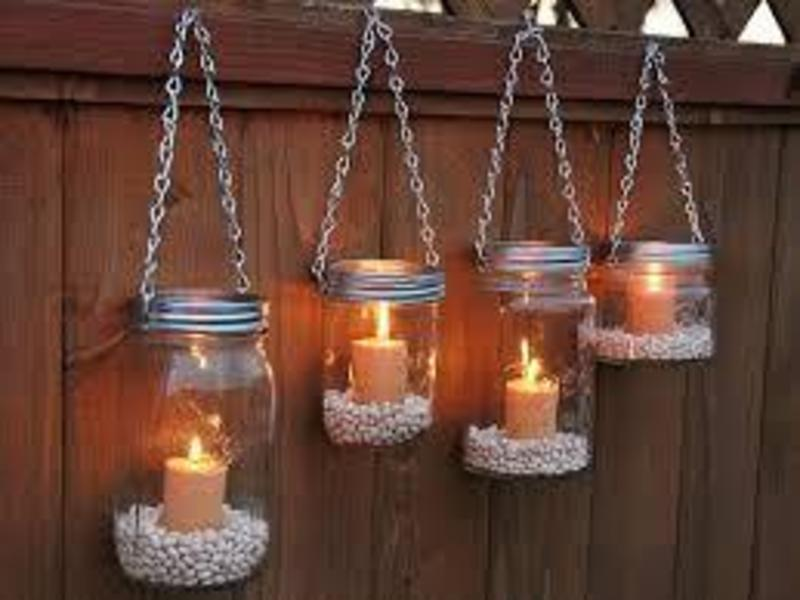 mason jar lighting hanging on a fence