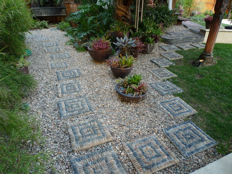 Aztec inspired dry creek bed garden path